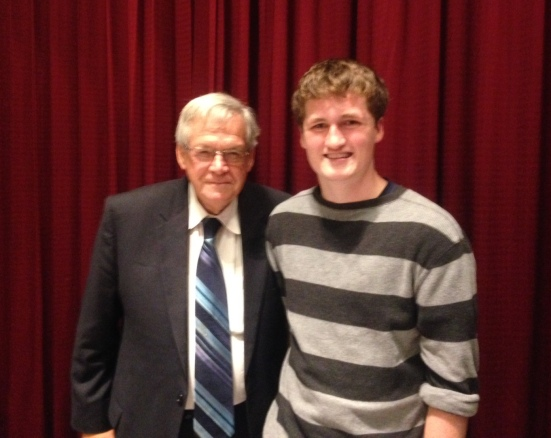 Hastert meets with a young fan during a campaign stop